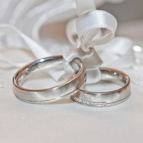 Wedding Rings bound with white ribbon